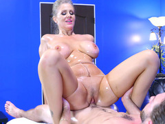 Julia Ann in ripped pantyhose rides him on the table