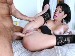 Veronica Avluv in stockings and high-heeled boots gets ass fucked