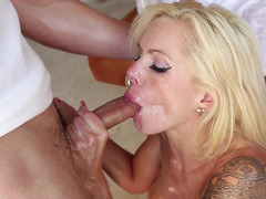 Nina Elle sucks him until his cock is rock hard and then does a titjob