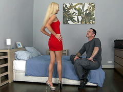 Victoria Puppy in a red tight dress posing and undressing