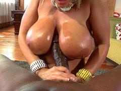 Lisa Ann slides that monster black snake between her giant tits