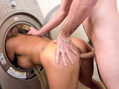 Long haired busty blonde Tegan James dogged in the laundry