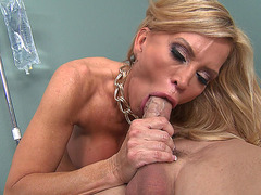 Mature pornstar Amber Lynn works over his dick orally