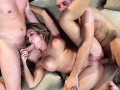 Capri Cavanni takes one dick in her cunt and the other in her mouth