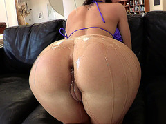 Melina Mason gets her butt filled with oil