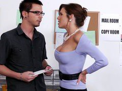 Busty boss Veronica Avluv seducing young guy in the office