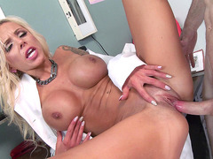 Round boobed doctor Nina Elle taking it up her shaved pussy