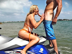 Nikki Benz sitting on her watercraft sucking his shaft