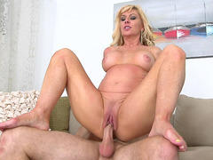 Natural-boobed mommy Sasha Sean bounces on the cock