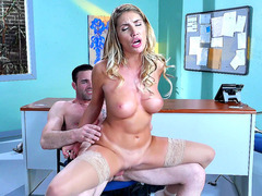 Busty secretary August Ames rides her boss in the office