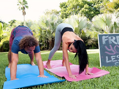 Latina Victoria June does yoga exercises outdoors