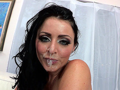 Sophie Dee gets her face sprayed with a big load of sperm