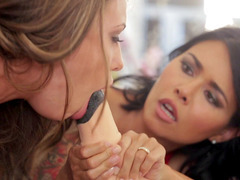 Dana Vespoli employing a horse-cock-shaped dildo to test Adriana Chechik's sucking abilities