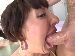 Dollie Darko makes a big fat cock disappear down her throat